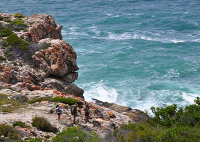 Hikers enjoying the spectacular view on the hike fron Noetsie to Hamerkop on the Whale Trail Adventure