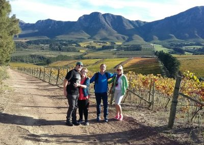 Wine Tasting Walks with a group of Slackpacking friends resting near one of the many vineyards